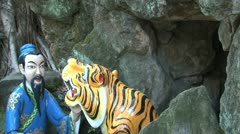 Tiger and chinees people statue Stock Footage