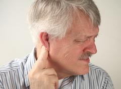 Pain around the ear.jpg Stock Photos