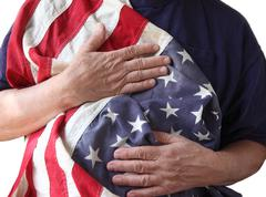 USA flag held by a veteran.jpg Stock Photos