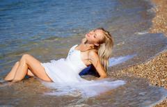 bride on the beach - stock photo