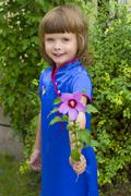 Girl with a flower Stock Photos