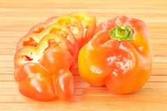bulgarian pepper on a background of the boards - stock photo
