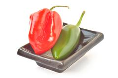 multi-colored peppers on a white background - stock photo