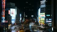 Stock Video Footage of Night Traffic Crowds, Shinjuku Neon Sign Street, Shopping Area in Tokyo, Japan