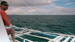 Man on the Philippine bangka boat Stock Footage