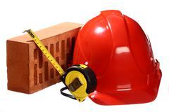 brick, tape-line and helmet - stock photo