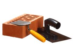 Trowels and a brick Stock Photos