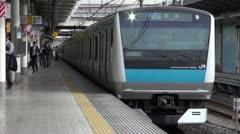 Keihin Tohoku Train Departs Ueno Station - stock footage