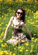 Happy young woman enjoying the sun on a meadow Stock Photos
