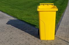 Yellow recycling container Stock Photos
