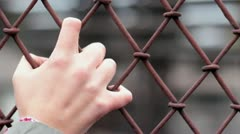 A woman hand on the lattice - stock footage