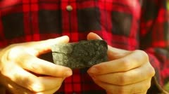 Holding coal country geologist Stock Footage