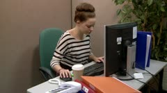 Teenage office worker answering a call Stock Footage