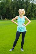 Young woman doing fitness outdoor Stock Photos