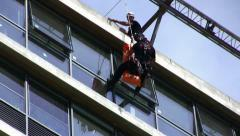 Firefighter rescues casualty by rappelling from Tel Aviv Municipality building Stock Footage