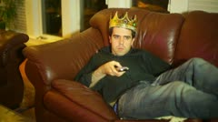 king of the remote sofa man of the house - stock footage
