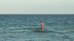 Paddleboarder on Ft Lauderdale beach Stock Footage