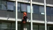 Stock Video Footage of Firefighter rescues casualty by rappelling from Tel Aviv Municipality building