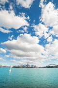 clouds over skyline of sydney with city central business district and sydney  - stock photo