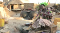 Burkina Faso:  Woman Stirs her Cornmeal Stock Footage