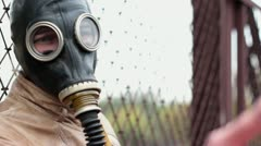 The man in the gas mask calls to himself - stock footage