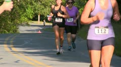Triathlon runners pass water station; 13 Stock Footage