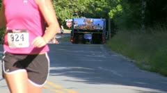 Triathlon runners pass water station; 16 Stock Footage