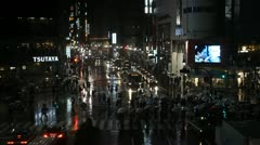 Monsoon Rainy Evening Night Lights Crowd Walk Street Pedestrians Crossing Tokyo - stock footage