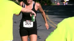 Triathlon runners pass water station; 29 Stock Footage