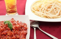 Plate of pasta with tomato Stock Photos
