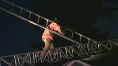 Fireman going up the Aerial latter with a latter Stock Footage
