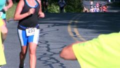 Triathlon runners pass water station; 32 Stock Footage