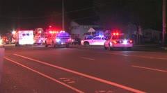Wide shot emergency vehicles at crash Stock Footage