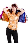 Woman looking puzzled while choosing whilst shopping Stock Photos