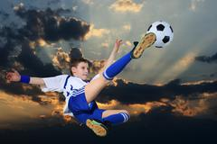 Soccer player against the backdrop of cloudy skies Stock Photos