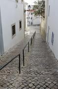 Cobblestoned street in Albufeira, Portugal Stock Photos