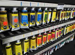 Artist tube acrylic paints display shelf Stock Photos