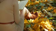 Stock Video Footage of Girl Reading Lecture Notes in the Autumn Park