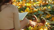 Stock Video Footage of Student Reading Lecture Notes in Autumn Park