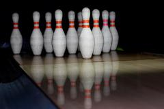 Bowling pins on wooden lane Stock Photos