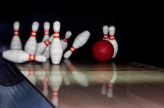 bowling pins on wooden lane - stock photo