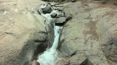 Stream Rushing Over Rock Stock Footage
