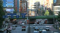 Shinjuku crossroad and train at daytime Stock Footage