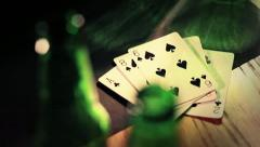Beer Bottles Pull Focus to Playing Cards - Close Up HD Stock Footage
