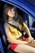 girl in car fastened by seat belt - stock photo