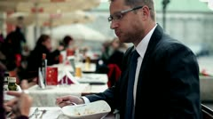 Business people with cellphone eating dinner in the restaurant, outdoor Stock Footage
