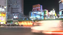 Shinjuku traffic timelapse pan Stock Footage