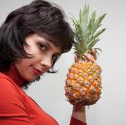 Girl with pineapple Stock Photos