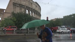 Urban traffic near the coliseum. Rain in Rome Stock Footage