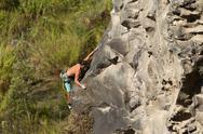 Rock Climber Climbing Up A Cliff Stock Photos